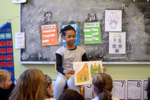 Maternelle students enjoy story time with middle schoolers