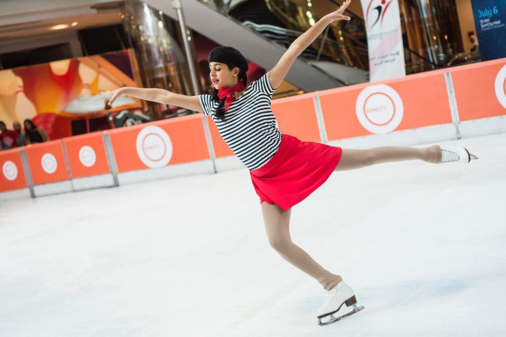 A student ice skating in a rink