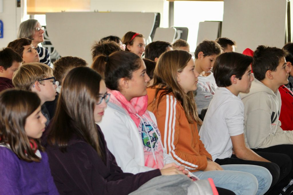 Middle school students listen to the presentation by NOAA